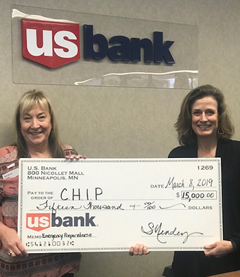 U.S. Bank's Branch Manager Sally Needham-Mendez presents a $15,000 check to CHIP's Director of Rental Housing, Kris Zappettini